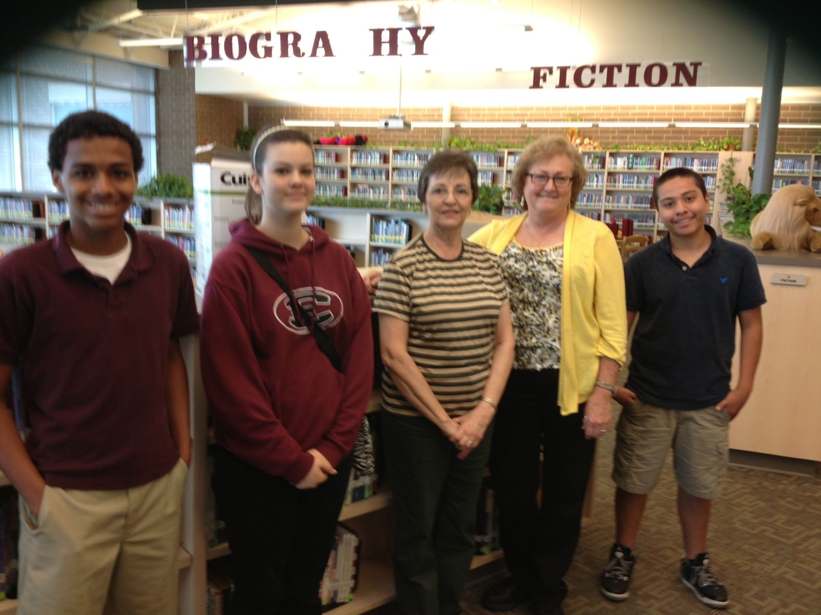 Students Jayden Owens, Kelsey Puckett, Jose Cisneros along with Librarian Lori Little welcomed Patricia Rider as she delivered books from The Children's ...